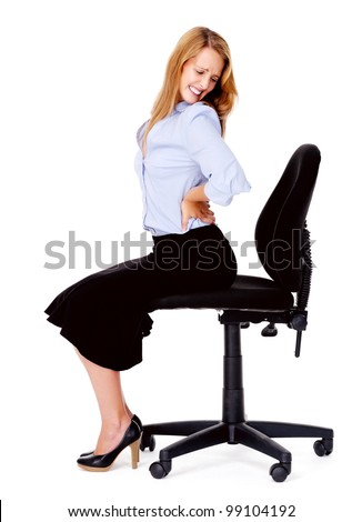 Business woman has back pain from sitting in office chair - stock photo