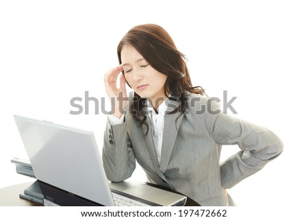 Business woman having a headache - stock photo