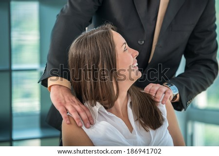 Business woman having fun with colleague at workplace - stock photo