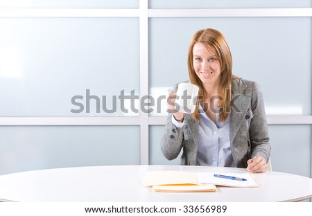 BUsiness woman having her morning coffee - stock photo