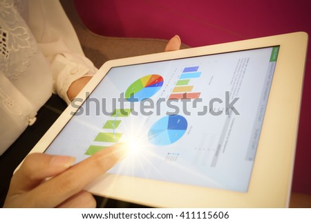 business woman hold analyzing financial chart on tablet , strategy concept , business idea , business concept - stock photo
