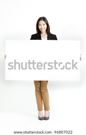 Business woman holding a banner ad. - stock photo