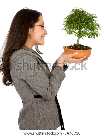 business woman holding a bonsai tree isolated over a white background - stock photo
