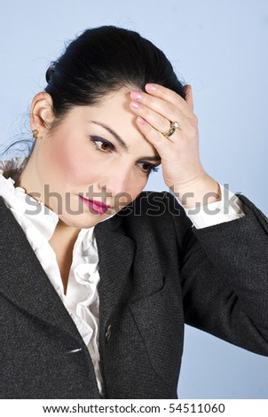 Business woman holding a hand  on forehead like she having a headache or just some problems - stock photo