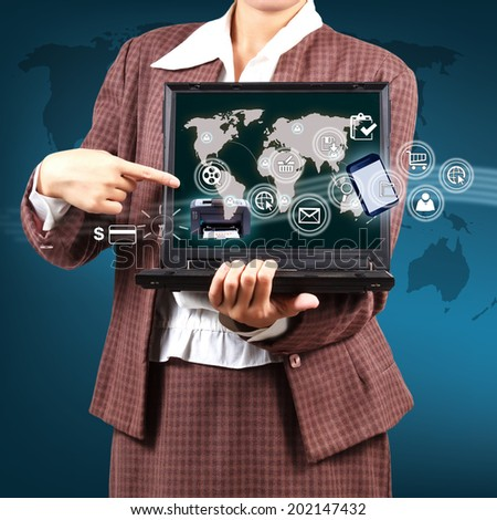 Business woman holding a laptop showing map and icon application on virtual screen. Concept of online business. - stock photo