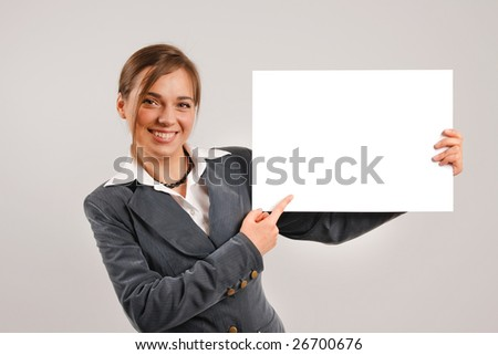 Business woman holding a large blank card - stock photo