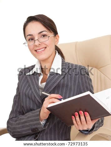 Business woman holding a notepad and pen - stock photo