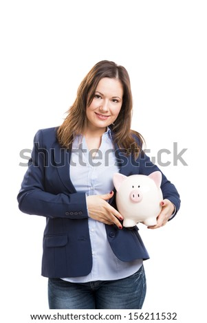 Business woman holding a piggy bank, isolated over white background