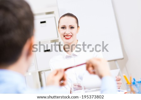 business woman holding an interview with a man in the office