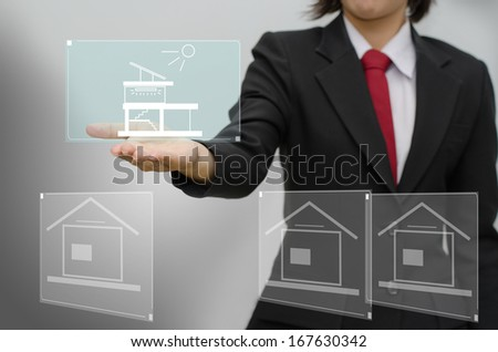Business woman holding best office with hologram screen