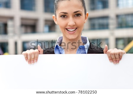 business woman holding blank paper for advertisement - stock photo