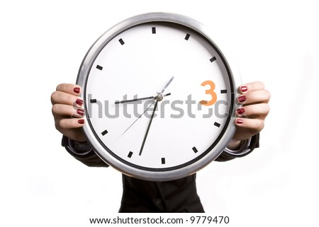 business woman holding giant alarm clock - stock photo