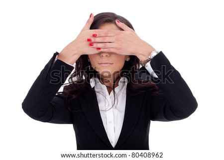Business woman holding her hand at her eyes - stock photo