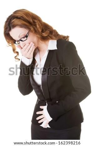 Business woman holding her stomach and covering mouth. Isolated on white.