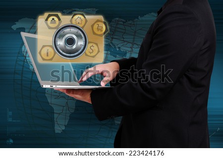 Business woman holding laptop  with wifi connection. Concept of online business. - stock photo