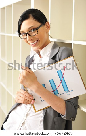 business woman holding reports until 2013 and looking at camera. Copyspace - stock photo