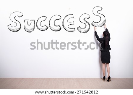 business woman holding success with white wall background, asian - stock photo