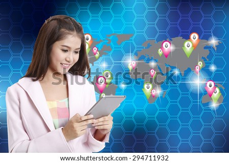 Business woman holding tablet computer  on map social background