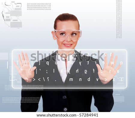 Business woman in a dark suit and transparent glasses clicks on virtual buttons. Collage - a symbol of high-tech future - stock photo