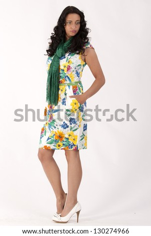 Business woman in a floral dress with green scarf / Elegant business woman in the summer - stock photo