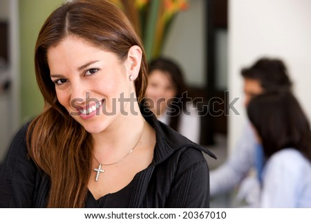 business woman in an office leading a team
