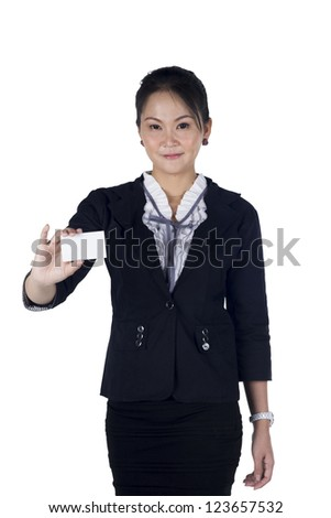 Business woman in black suit handing a blank business card, Isolated on white background. Model is Asian woman. Focus at the card - stock photo