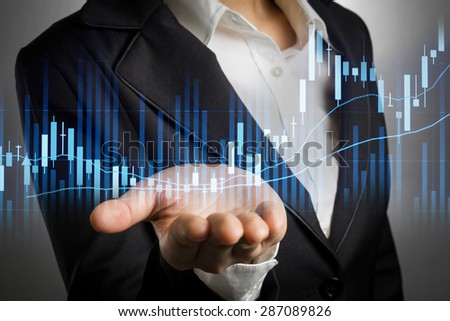 business woman in black suit with bear hand for support stock financial graph. - stock photo