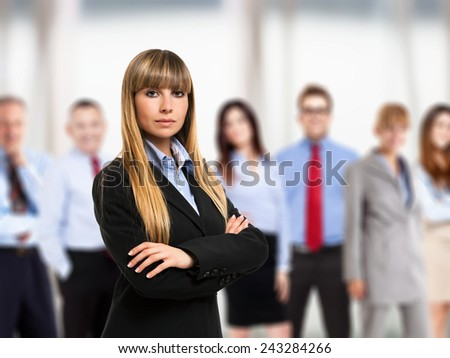 Business woman in front of a group of business people - stock photo