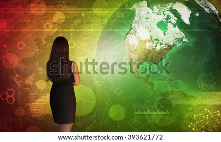 Business woman in front of holographic screen