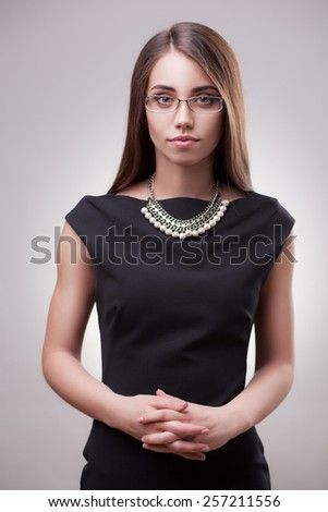 Business woman in glasses on gradient background - stock photo