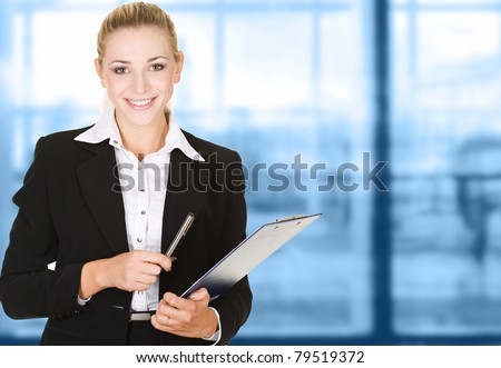 business woman in modern glass interior - stock photo
