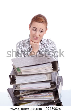 business woman in office looks at unbelievable folder stack isolated on white - stock photo