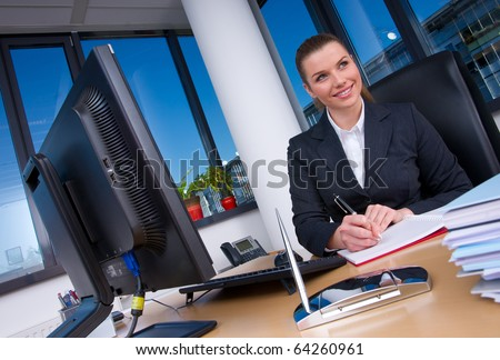 business woman in office working at the desk