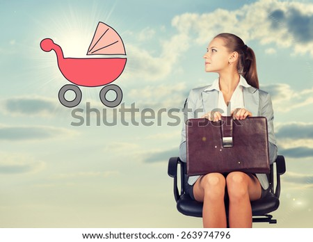 Business woman in skirt, blouse and jacket, sitting on chair and holding briefcase imagines buggy. Against background of sky and clouds - stock photo