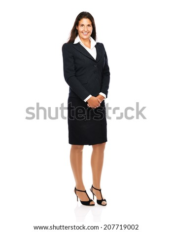Business woman in suit smiling looking into camera.   Isolated on a white background.