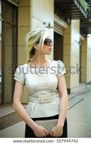 business woman in sunglasses on the street - stock photo