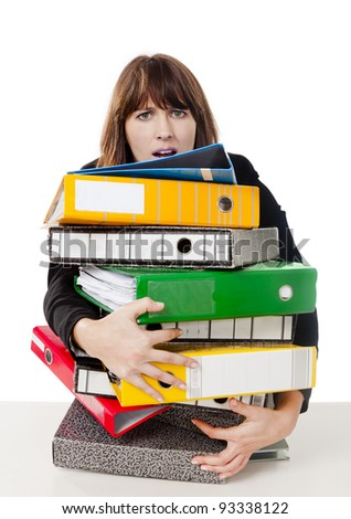 Business woman in the office embracing a pile of folders, isolated on white background - stock photo