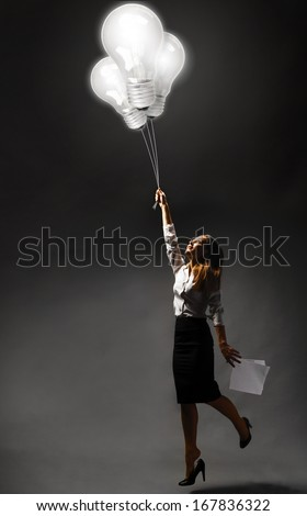Business woman is flying away with inspiration - stock photo