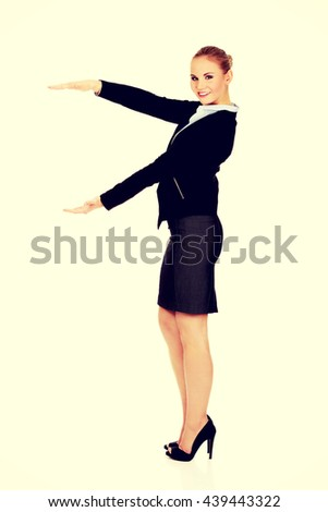 Business woman is having empty space between her hands - stock photo
