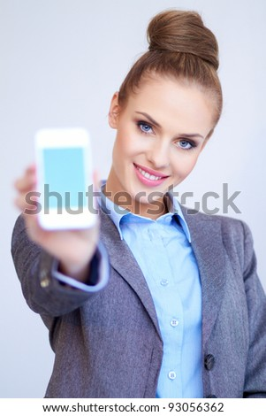 Business woman is showing smart phone - stock photo