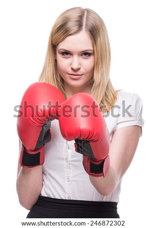 Business woman is wearing boxing gloves and business suit on the white background. - stock photo