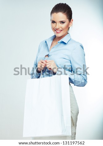 Business woman isolated portrait hold shopping bag . Smiling woman . - stock photo