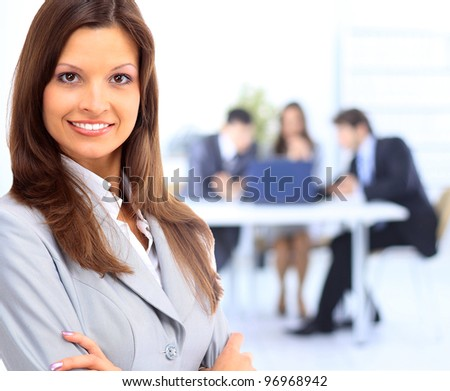 business woman leading a corporate team - stock photo