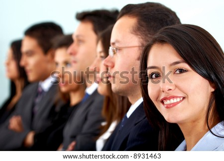 business woman leading a team in an office - stock photo