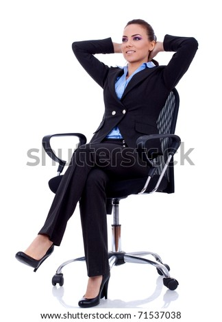 business woman leaning back in a black chair dreaming - stock photo