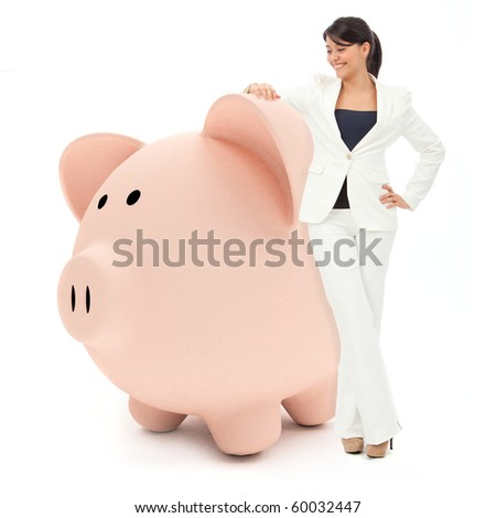 Business woman leaning on a piggybank - isolated over white - stock photo