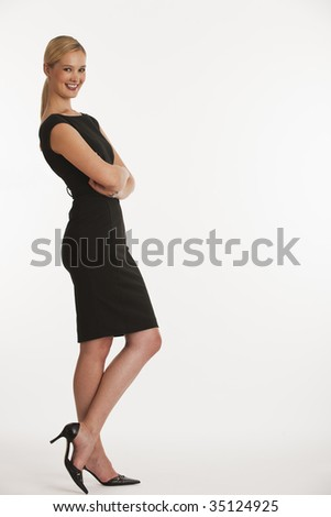 business woman leaning on copy space with white seamless background - stock photo