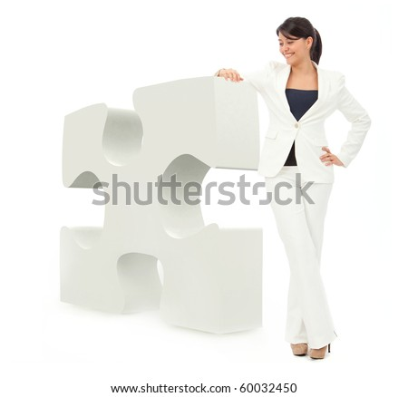 Business woman leaning on the piece of a puzzle - isolated over white - stock photo