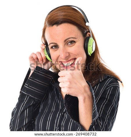 Business woman listening music - stock photo