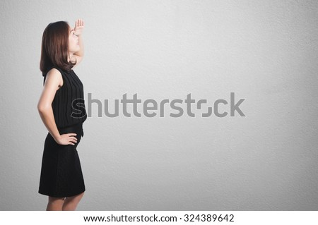 Business woman looking  on blank wall for text and background.Copy Space - stock photo